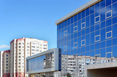 Modern rectangular building in a residential area. Grodno, Belarus - August 8, 2016: A modern rectangular building in a residential area made of white panels Stock Photography