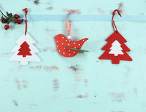 Modern Red And White Christmas Hanging Bird And Tree Decorations On Aqua Blue Wood Background. Stock Image