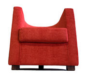 Modern red armchair. Modernly designed using curved and flat lines, completely covered by red textile, including quality, wooden legs Royalty Free Stock Images