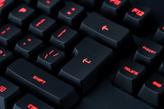 Modern red backlit keyboard, concept computer technology background Royalty Free Stock Photos