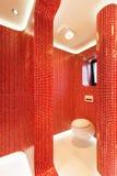 Modern red bathroom Stock Photos