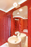 Modern red bathroom Stock Photo