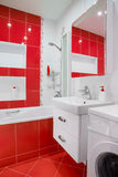 Modern red bathroom interior with mirror and showe Royalty Free Stock Photo