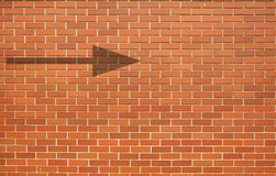 Modern red brick wall Grunge background with arrow on brick wall Royalty Free Stock Images