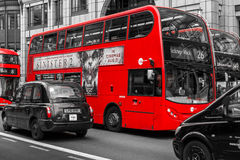 Modern Red Buses and Black Cabs in London Bishopsgate Stock Images