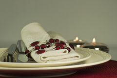 Modern red candlelit table place setting, close up Royalty Free Stock Images