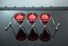 Modern red candlestick with three candles Royalty Free Stock Photo
