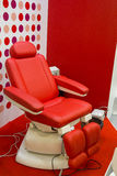 Modern red chair for spa salon. Furniture Stock Photos