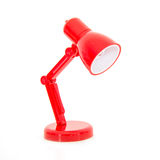 Modern red color desk lamp on white background Stock Photo