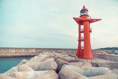 Modern red color lighthouse at Jeju Island - South Korea Royalty Free Stock Photography