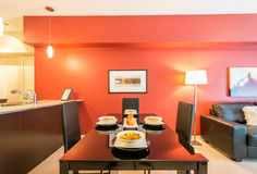 Modern red dining room. With kitchen in a luxury apartment. Interior design Royalty Free Stock Image