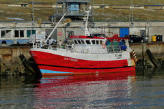 Modern Red Fishing boat alongside the wharf. Royalty Free Stock Images