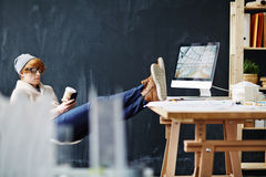 Modern Red Haired Man Relaxing in Office Royalty Free Stock Photos