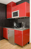 Modern red kitchen Stock Photography