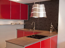 Modern red kitchen Stock Photos