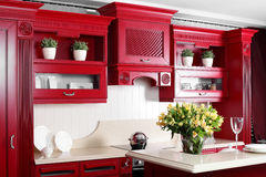 Modern red kitchen with stylish furniture Stock Photo