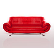 Modern Red Leather Couch. Modern stylish couch with arms and a metal frame upholstered in red leather, studio over white Stock Image