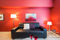 Modern red living room. Modern bright, red living room in a luxury house. Interior design Royalty Free Stock Images