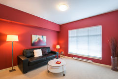 Modern red living room. Modern bright, red living room in a luxury house. Interior design Stock Photos