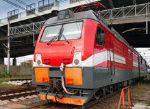 Modern red locomotive on railway station. Closeup photo of modern red locomotive on railway station Stock Images
