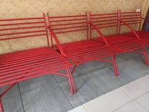 Modern red metal chair in the shop . Rebar make furniture. A red metal chair in the shop stock photos