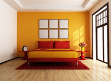 Red and orange contemporary bedroom Stock Photography