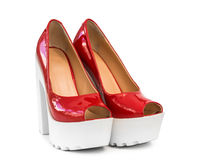 Modern red patent leather shoes on white heels Royalty Free Stock Image