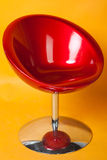Modern red round chair. A modern red round chair on yellow background Stock Images