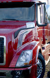 Modern red semi truck big rig on parking lot Royalty Free Stock Images