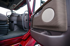 Modern red semi truck brown interior gorgeous place to work Royalty Free Stock Photos