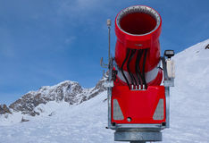 Modern red snow cannon in sunny day Royalty Free Stock Photo