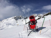 Modern red snow cannon in sunny day Stock Photography