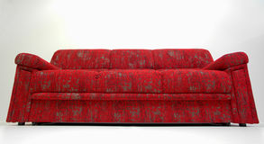 Modern red sofa. Modern line design, upholstered in red quality textile, use for sitting and sleeping Stock Image