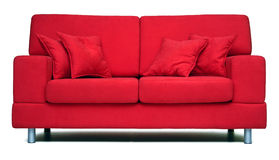 Modern red sofa. Luxury designed, covered with high quality red textile. Including four pillows Royalty Free Stock Photography