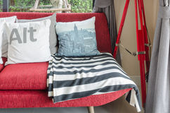 Modern red sofa with pillows in living room Stock Photos
