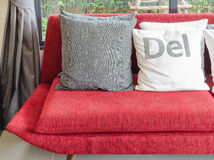 Modern red sofa with pillows in living room Royalty Free Stock Images
