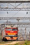 Modern red suburban electric train Stock Photos