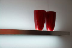 Modern red vases on a shelf Royalty Free Stock Image