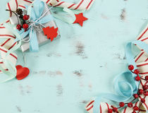 Modern red and white Christmas decorations on aqua blue wood background. stock images