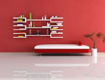 Modern red and white couch and bookcase Royalty Free Stock Photography
