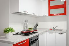 Modern red and white kitchen interior royalty free stock photo