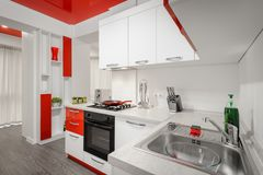 Modern red and white kitchen interior stock images