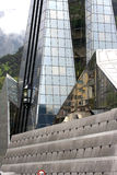 Modern reflecting glass pyramid (detail). This futuristic high glass spire building is situated in the capital of Andorra, Andorra la Vella, and is housing a Stock Photos