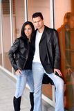 Modern relationship. Couple outside wearing leather jacket royalty free stock photography