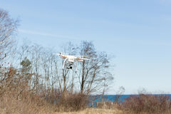 Modern Remote Control Air Drone Flying. Stock Photo