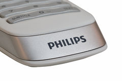 Modern remote control of smart TV Philips closeup, isolated. Royalty Free Stock Photography