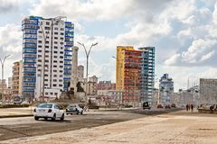 Modern resedential buildings close to Malecon promenade and road. With cars, Vedado, Havana, Cuba Royalty Free Stock Photo