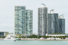 Modern residencial buildings on Miami Beach with yachts docked n Stock Images