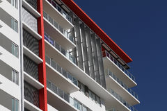 Modern Residential Apartment Block. Mostly white with red highlight, located in tropical Queensland Royalty Free Stock Photo