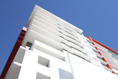 Modern Residential Apartment Block. Mostly white with red highlight, located in tropical Queensland Stock Images